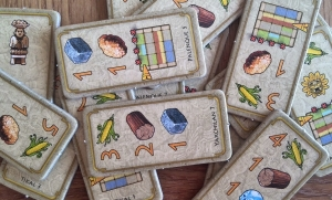 Each player chooses two of four of these starting chits  to decide their initial starting goods,  skills, money, workers and temple positions