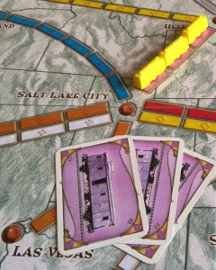 Yellow plays three pink cards to complete this three-train route between Helena and Salt Lake city