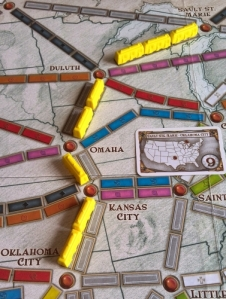 Yellow completes the 'Sault St Marie to Oklahoma City' route card; they'll keep it secret and score 9 points at the end of the game